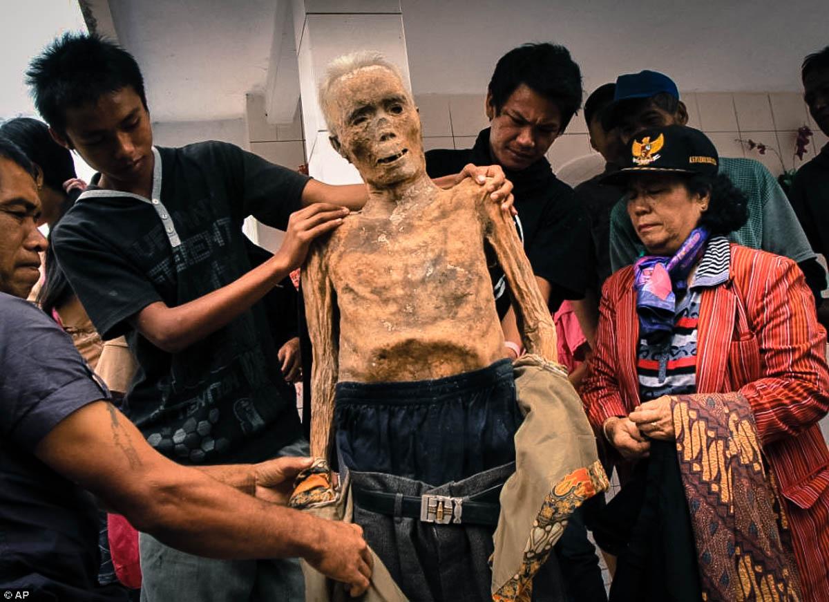 people of toraja indonesia unearth corpses
