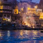 People swim with rotting corpses in Varanasi to cleanse themselves of sin