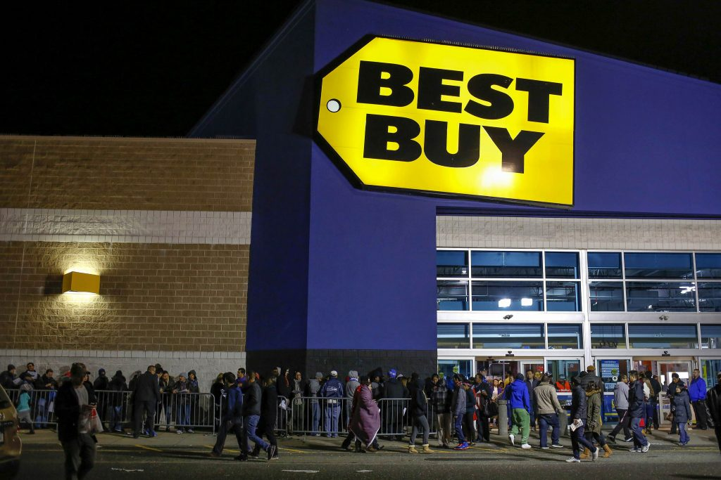 Shoppers enter and leave the Best Buy electronics store on the Thanksgiving Day holiday in Westbury, New York