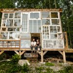 Artist couple built a cabin made of recycled windows in the West Virginia mountains for $500 (Video)