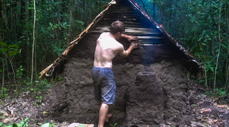 Building A Shelter In The Woods : This guy shows you how to build a woodland fortress and