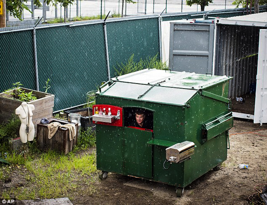 8_tiny house inside a dumpster