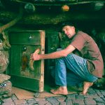 This guy lives in an underground hobbit hole in a majestic meadow for under $5,000 a year