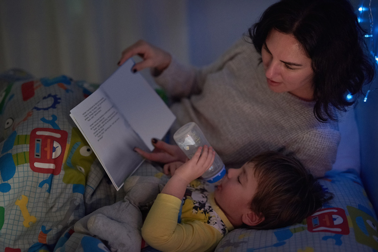 He always has his bottle and a book at bedtime
