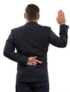 Rearview of a mature man swearing an oath with his fingers crossed behind his back