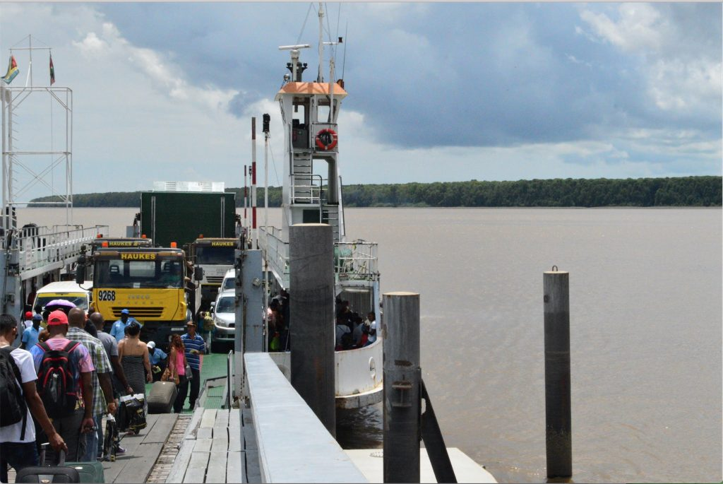 Passengers boarding the ferry at the Courtantyne River in Crabwood Creek, Guyana.